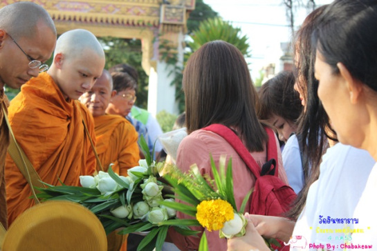 the morning after... phra Bie went outside the temple to accept food offering