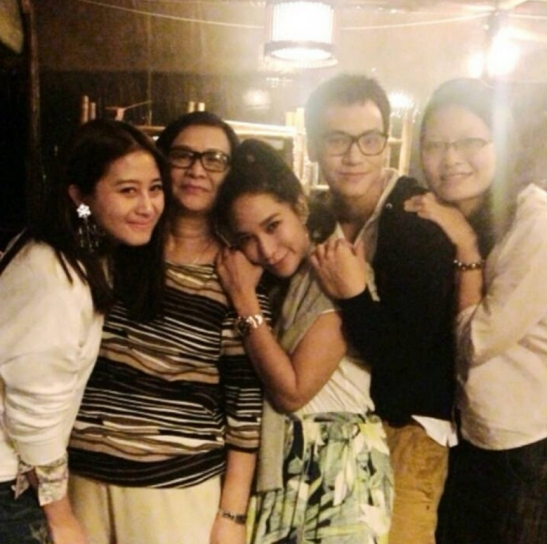 Bie and family with Ploy and her friend
