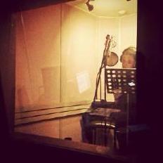in studio recording a new single